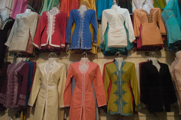 Photo clothes Marrakesh shop medina souk with traditional Moroccan clothes
