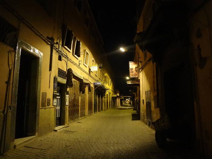 Photo of a Marrakech street in the old medina by night<br /><br />
