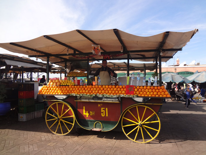Photo of orange juice street vendor in Jemaa el Fna main square in Marrakech Morocco